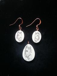 Scrimshaw earrings and pendant on ivory with horseheads for sale