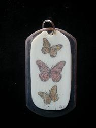 Butterflies on piano key on dog tag Scrimshaw Butterflies for sale