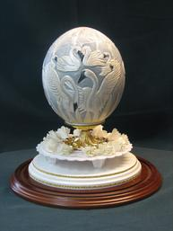 Swans carved on Ostrich egg cake topper